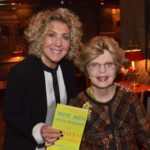Dr. Marianne Legato with guest holding the book Why Men Forgets And Women Never