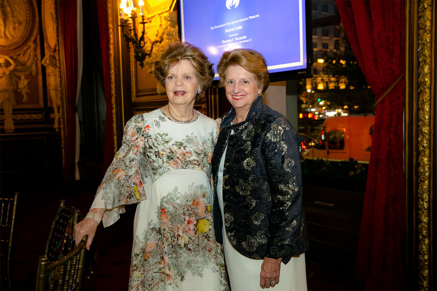 Dr. Legato and a lady stand together and pose during the 2019 Gala