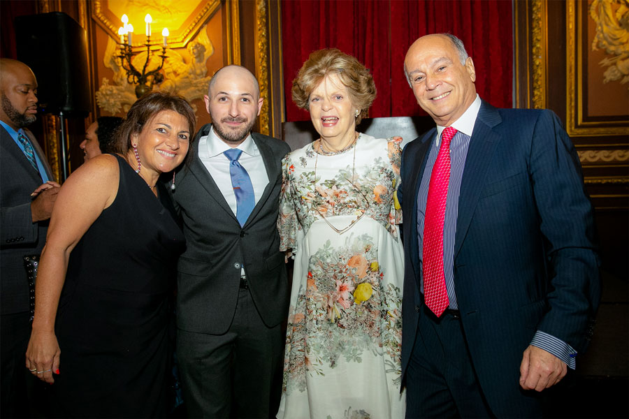 Dr. Legato stands with three people during the 2019 Gala