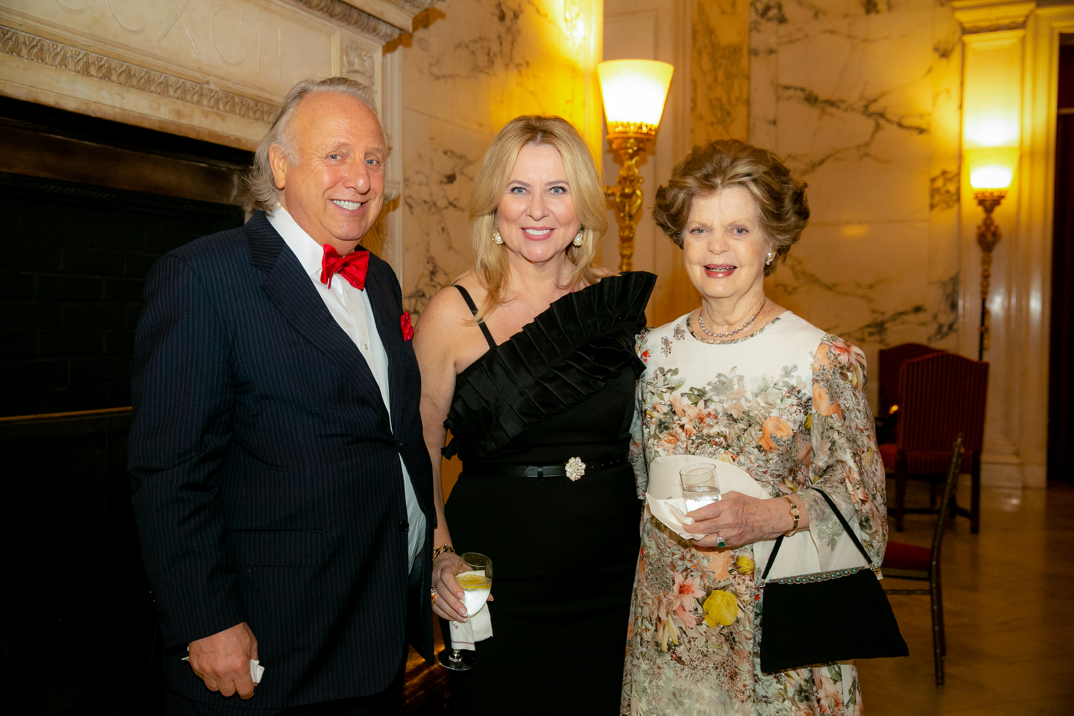 Dr. Legato standing with a man and woman at the 2019 Gala