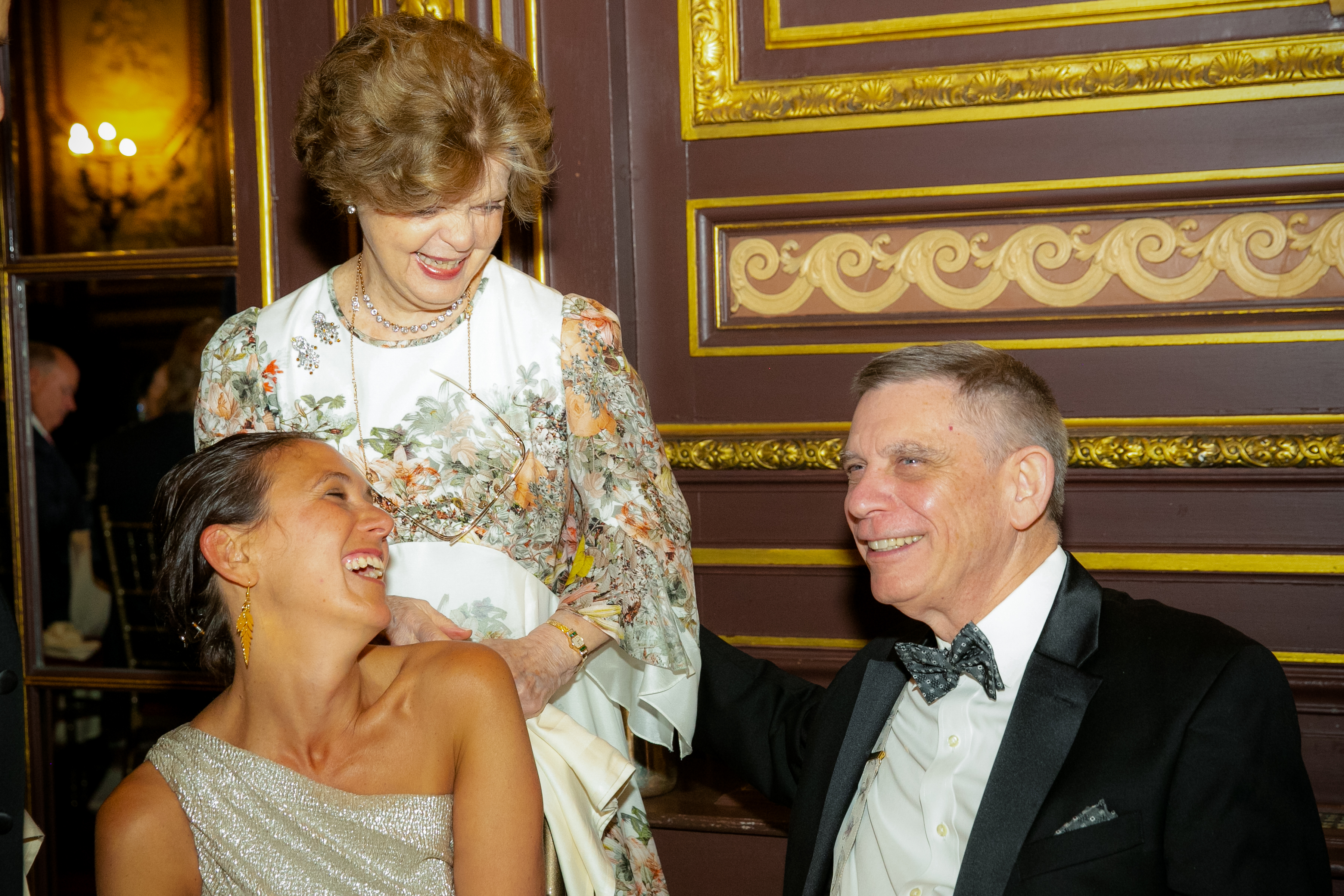 Dr. Legato standing and smiling with man and woman at gala
