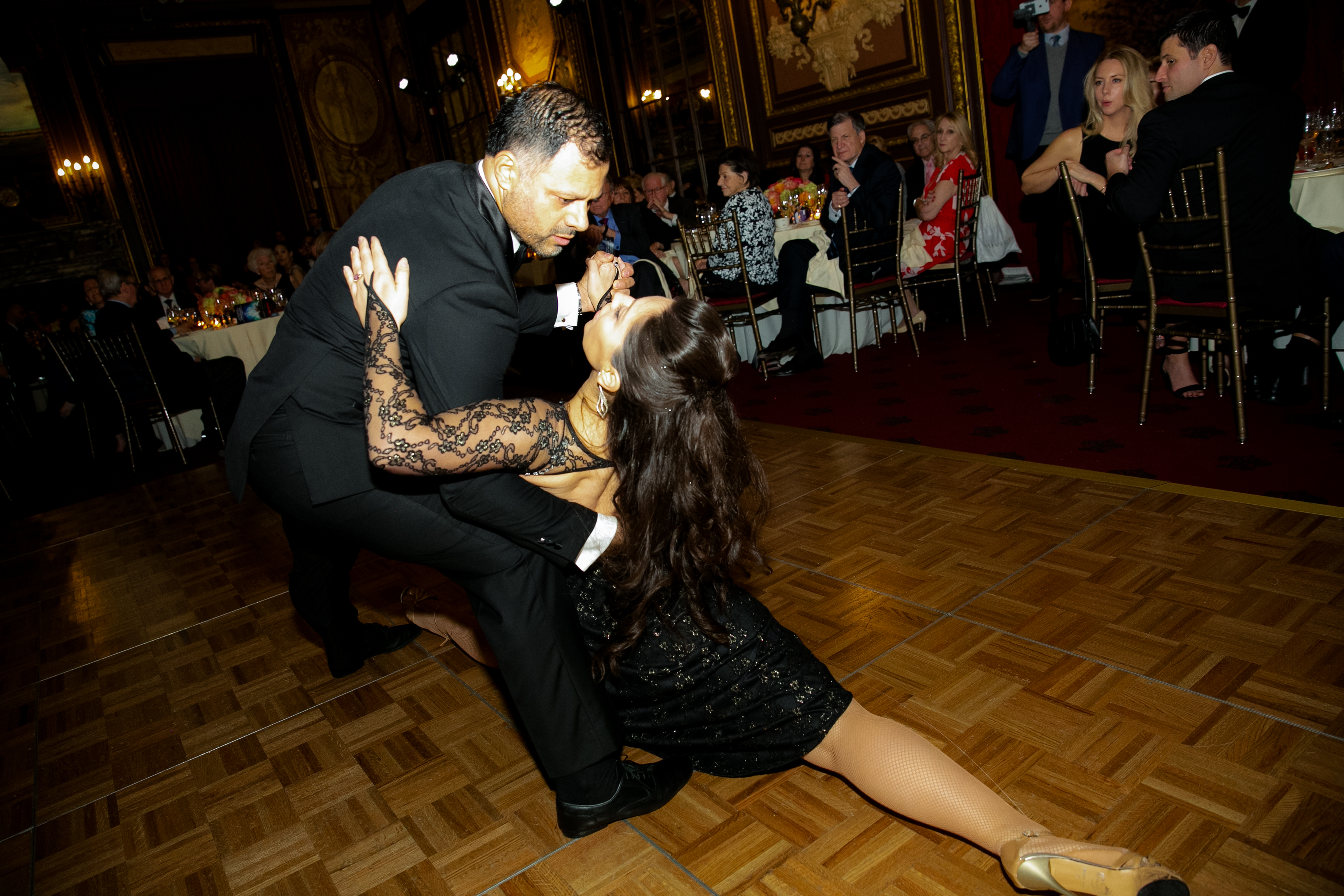 Man and woman dancing during the 2019 Gala while guests behind them watch