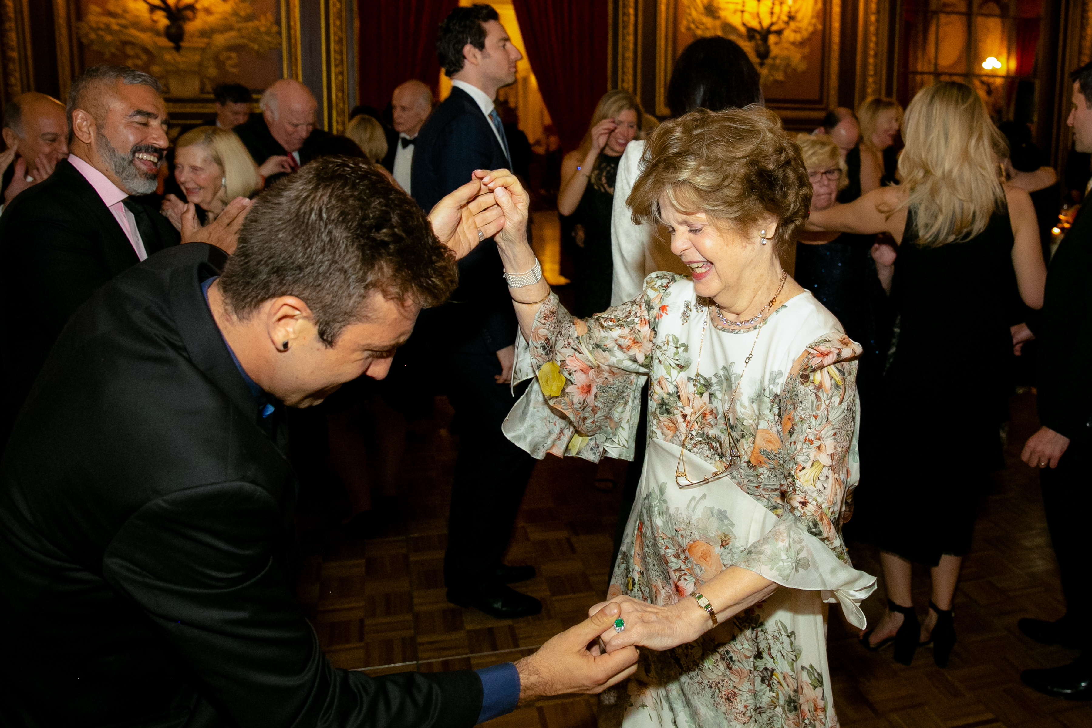 Dr. Legato dancing and smiling with a male guest during the 2019 Gala