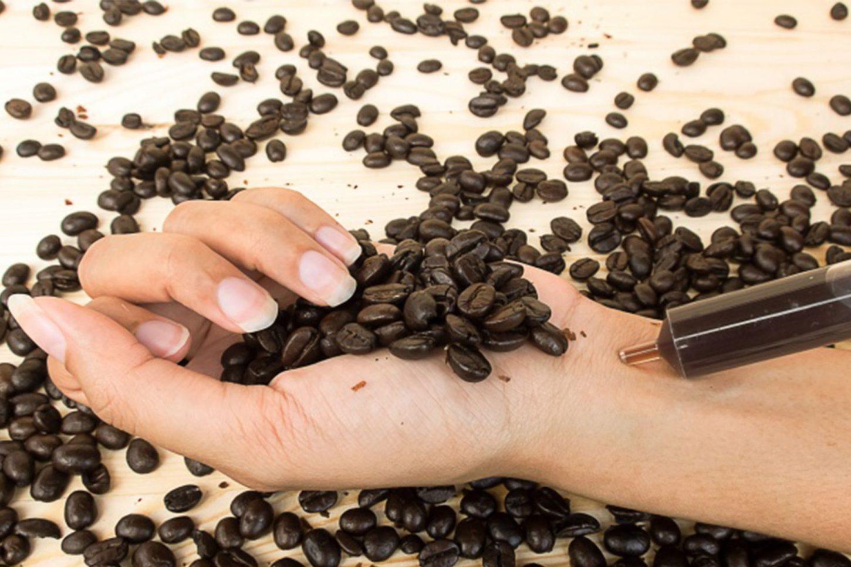 Women injecting caffeine in her wrist