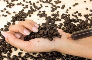Women injecting caffeine in her wrist