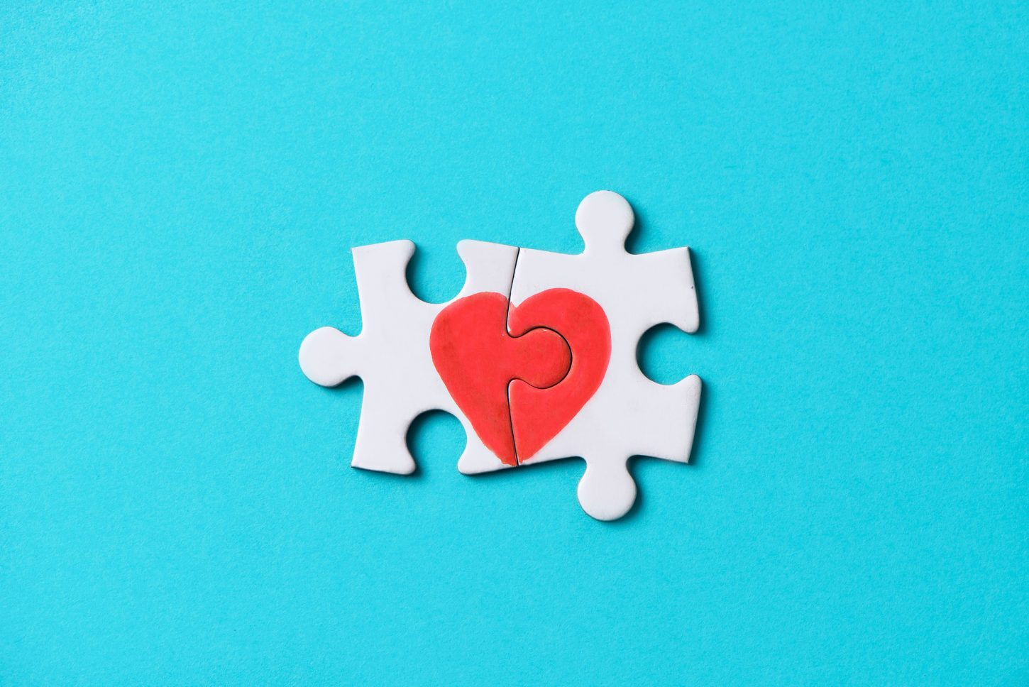 closeup of two pieces of a puzzle forming a heart