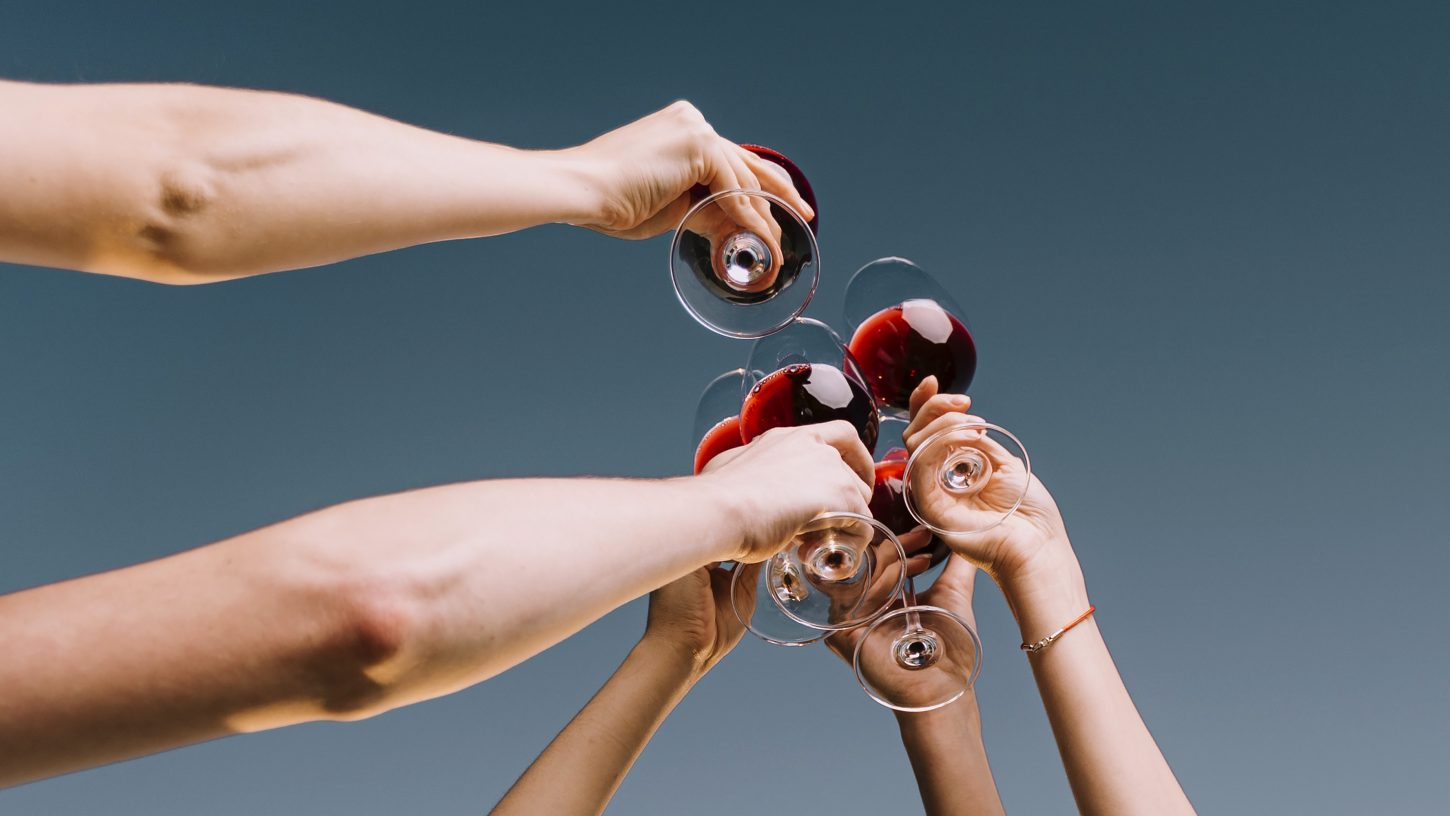 People hands with wine glasses