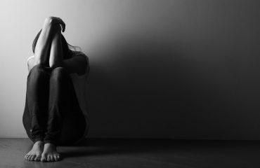 depressed women sitting down